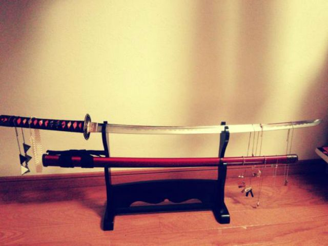 Japanese girl accidentally finds a new use for her decorative sword: accessory organizer
