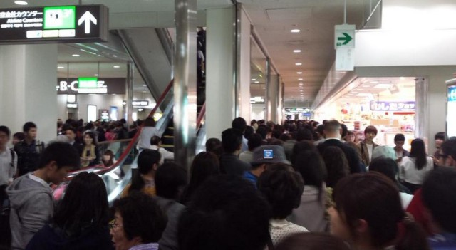Oblivious tourists wander back into Japanese airport's departure area, mass chaos ensues