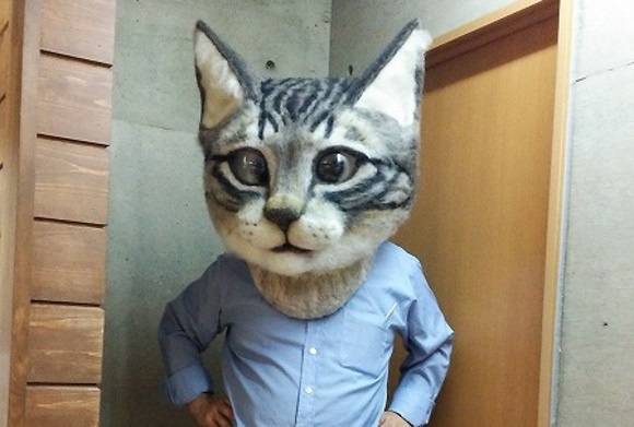 Giant, realistic cat head made from felt is impressive but kind of terrifying