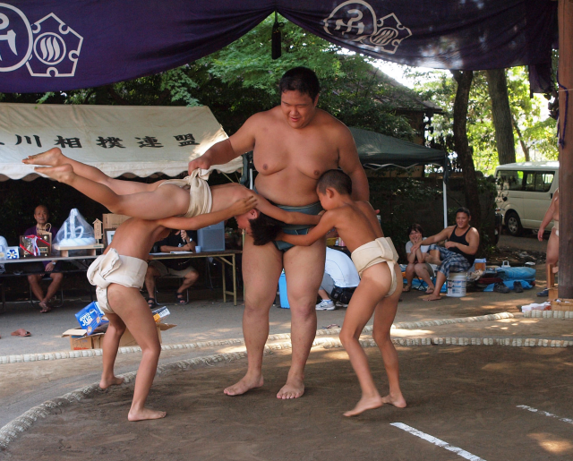 Japanese Fitness expert recommends toddlers play catch, climb on jungle gym, sumo wrestle