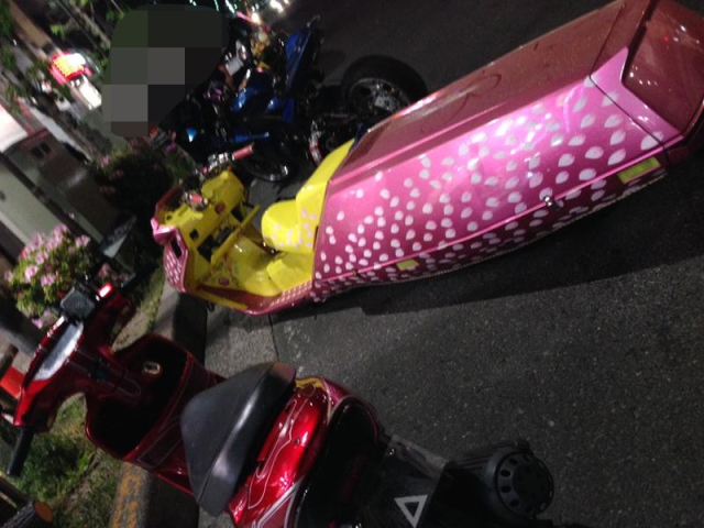 Limo-bike? Stretch scooter? Whatever you call it, it's long, pink and has two wheels