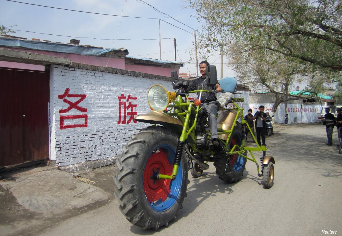 a-man-only-identified-as-abulajon-in-the-xinjiang-uighur-autonomous-region-in-china-spent-8000-yuan-820-1300-to-create-the-03-tonnes-motorcycle-however-measuring-14-feet-43-metres-in-length-and-78-feet-24-metres-in-height-makes-it-impossibl