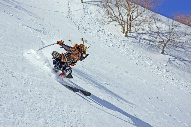 Skiing samurai shreds the slopes with katana ski pole