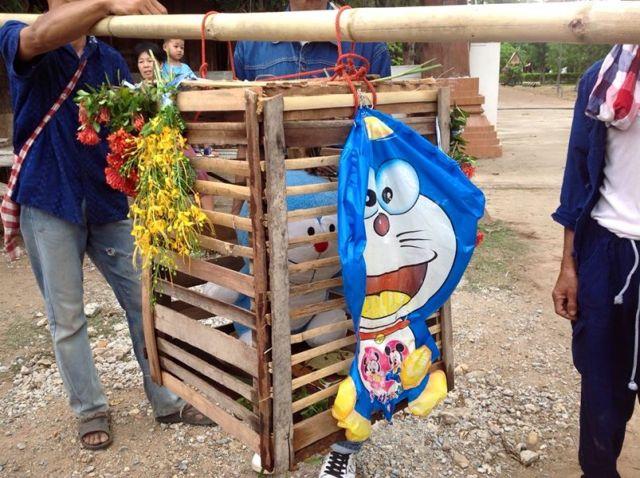 Doraemon replaces live cat for Thai rain ritual