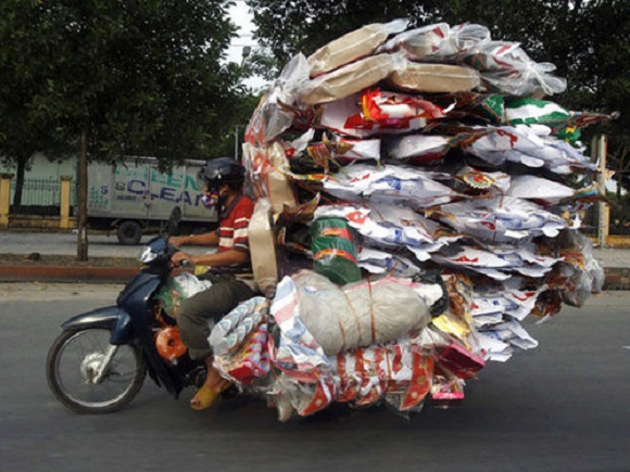 Defying gravity: 24 pictures of people carrying way too much stuff on their bikes