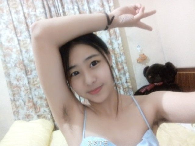 "Chinese women proudly show off natural look for ""2015 Armpit Hair Competition"""