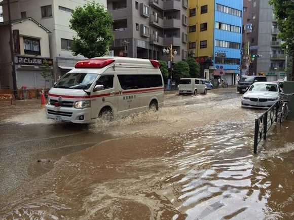 Rare Tokyo public works failure leaves crowded Tokyo street flooded with dirty water