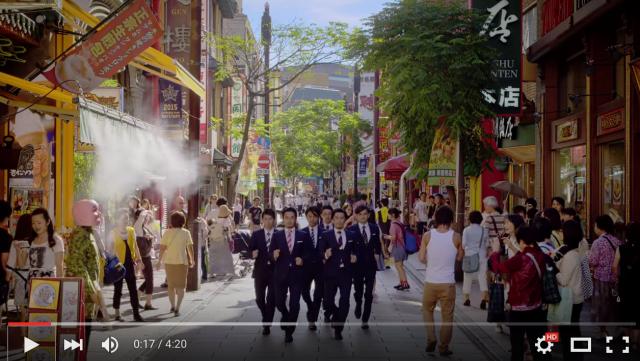 New World Order video sees the group dance through Yokohama's Chinatown – but where's Genki Sudo?