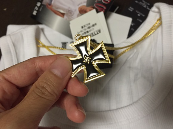 Japanese discount clothing chain selling swastika necklaces (also ugly tank tops)