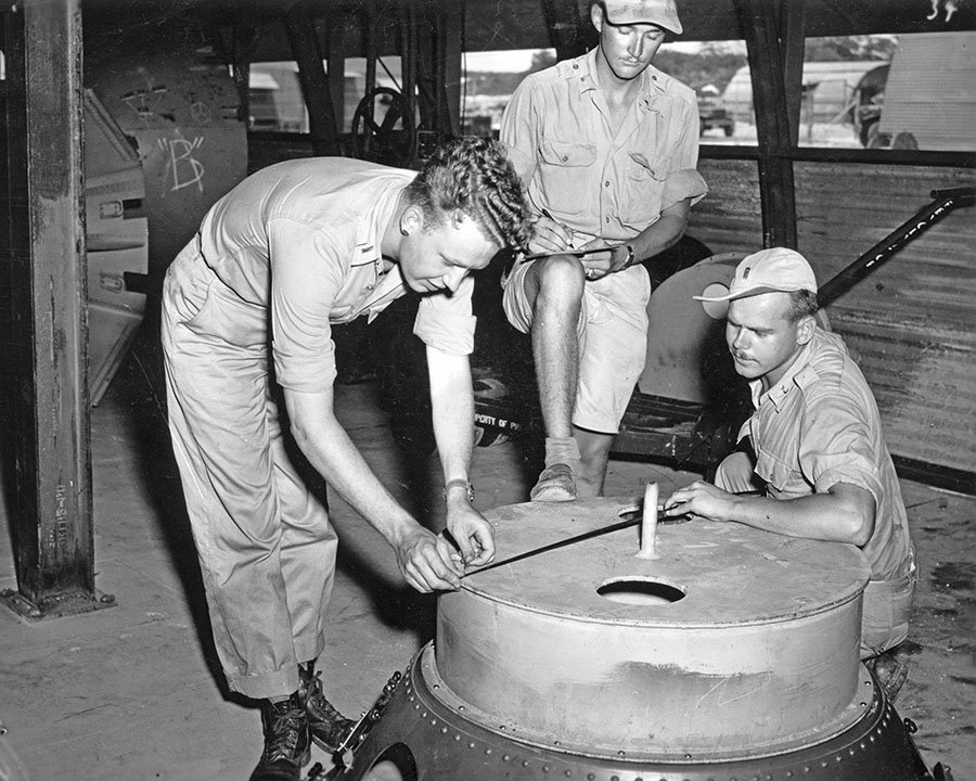 soldiers-check-the-casings-on-the-fat-man-atomic-bomb-multiple-test-bombs-were-created-on-tinian-island-all-were-roughly-identical-to-an-operational-bomb-even-though-they-lacked-the-necessary-equipment-to-detonate