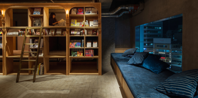 Bookstore-styled Tokyo hostel has 1,700 books to read, bunks in the shelves to sleep next to them