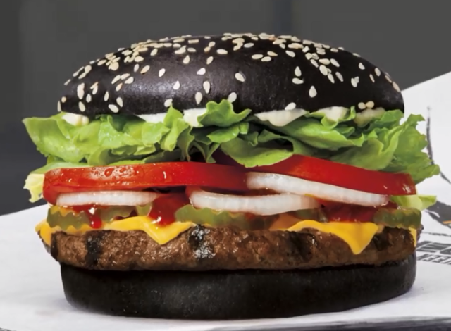 Why does Burger King's black burger turn poo green in the U.S. and the U.K., but not Japan?