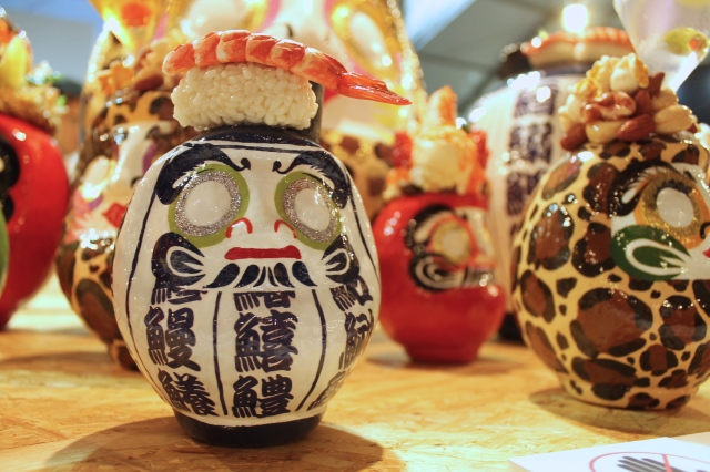 Designer makes daruma good enough to eat with sushi, parfait and fried pork