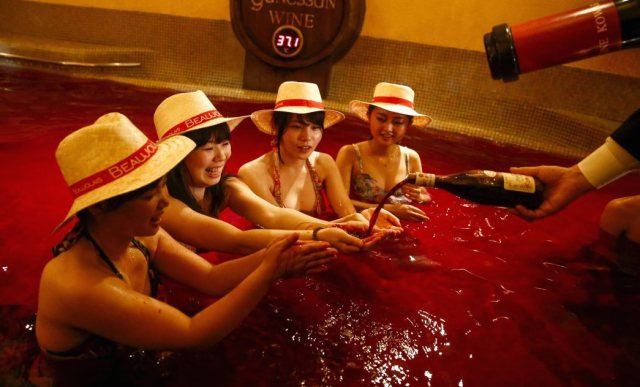 People in Japan are obsessed with a French holiday where you celebrate by bathing in a pool of wine