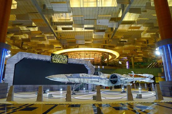 Star Wars X-wing fighter docks at Singapore airport, travelers encouraged to sit in its cockpit