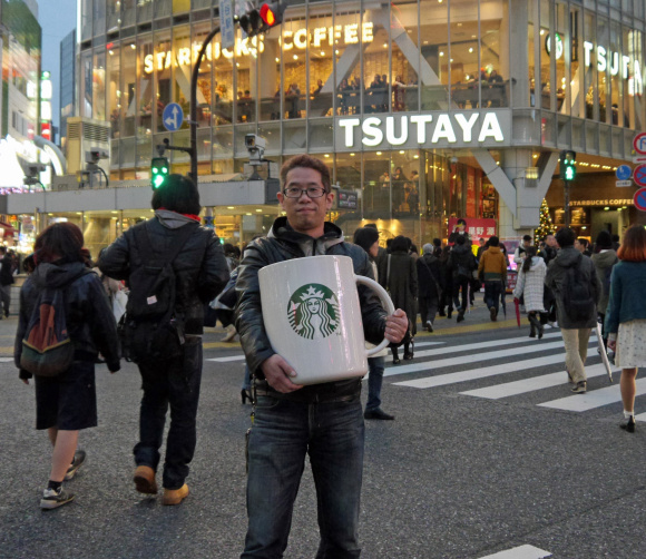 Mr. Sato decides to go out for a cup of coffee…with a giant 20-pound Starbucks mug!