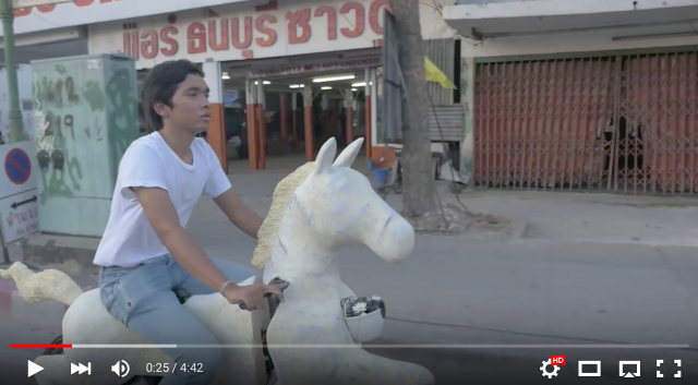 Video of a man riding a bicycle made to look like a white horse is both beautiful and bizarre