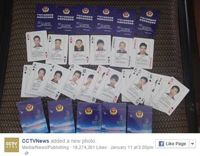 Police in China raise stakes on cybercrime with playing cards featuring wanted fugitives