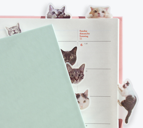 Cute adhesive cat tabs keep your pages marked with adorably playful poses