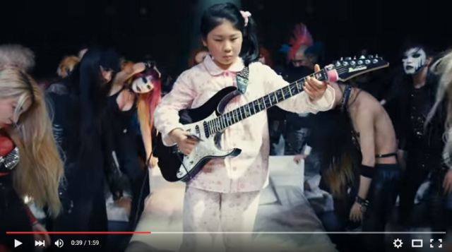11-year-old guitarist Li-sa-X appears in new commercial, rocks out using a debit card as a pick