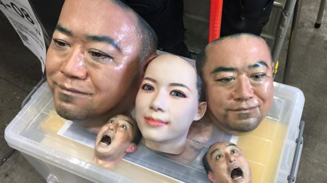 Japanese company's 3-D printed. disembodied faces and hands are both amazing and disturbing