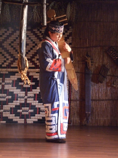 Woman_playing_traditional_Ainu_instrument