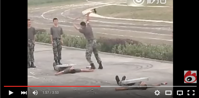 Chinese soldiers smash concrete blocks, break sticks on their various appendages【Video】