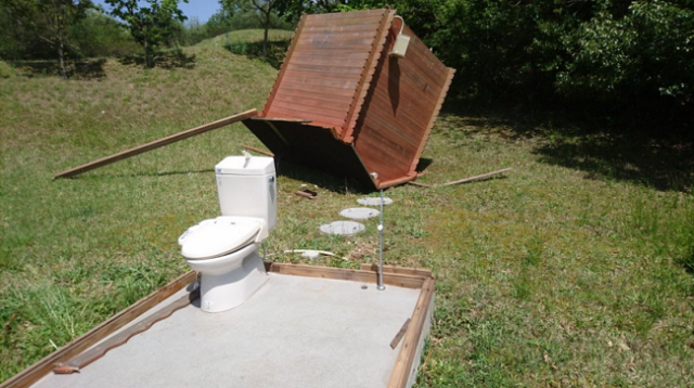 "Golf course outhouse is definitely ""out"" there with a little help from nature"