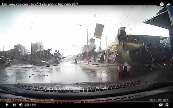 Vietnamese driver has dangerously close encounter with a tornado, catches it on video