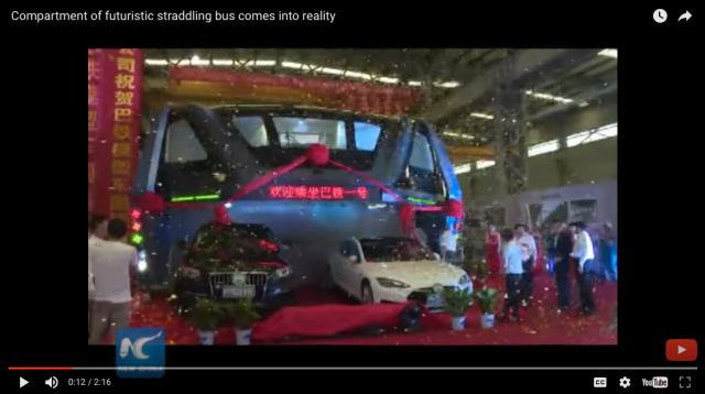 China's revolutionary elevated bus takes its first ride