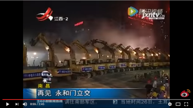 A hundred excavators line up along a road in China to make it disappear