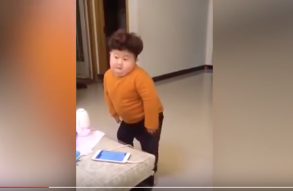 "Adorable toddler dubbed ""Mini Kim Jong-un"" shows remarkable sense of rhythm with cute dance moves"