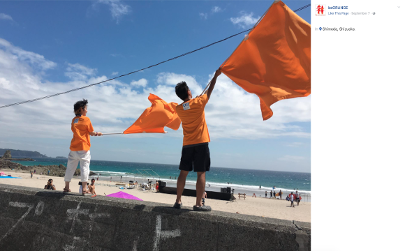 Japanese teams use orange flags as a tsunami alert signal for swimmers and surfers