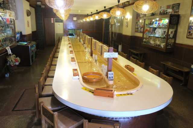 Japanese restaurant wows customers by serving meals on water instead of a revolving conveyor belt