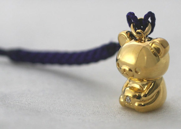 Rilakkuma appears in Japan as a 24-karat solid gold charm with a diamond belly button