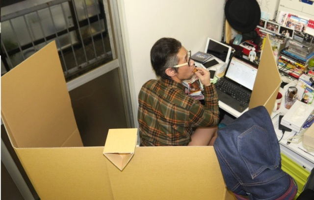 Mr. Sato installs a cardboard toilet in his workspace for maximum efficiency