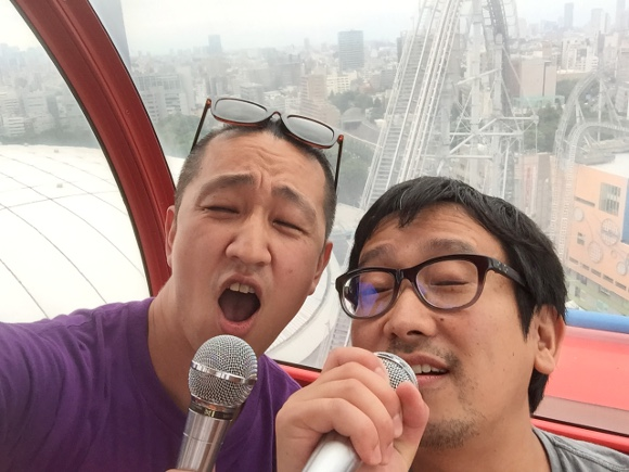 Enjoy karaoke while high! High up in a Ferris wheel that is