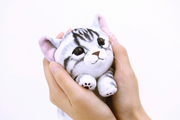 Japan's cuddly kitty pouches will fill your heart with love as you fill them with other stuff