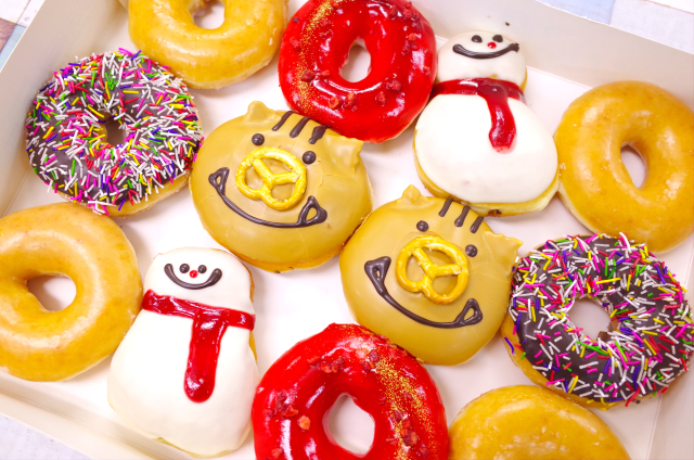 Krispy Kreme puts up a New Year's line of donuts and we're ready to scarf them down