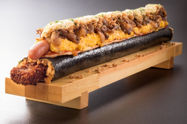 Japan's crazy 6,000-calorie sushi roll includes a pizza as a topping