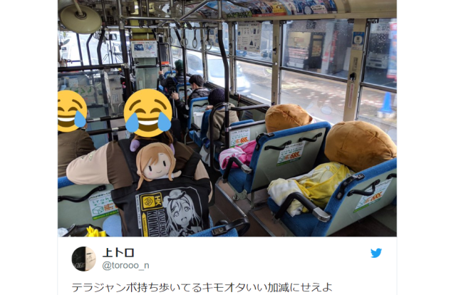 Love Live otaku takes up two seats on bus for himself, four for his anime plushie crushes