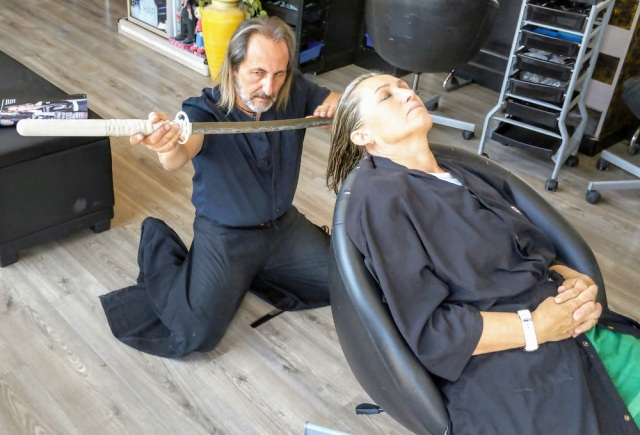 "We get a haircut by a stylist who cuts with katanas and fire at ""Samurai Salon"" in Spain"