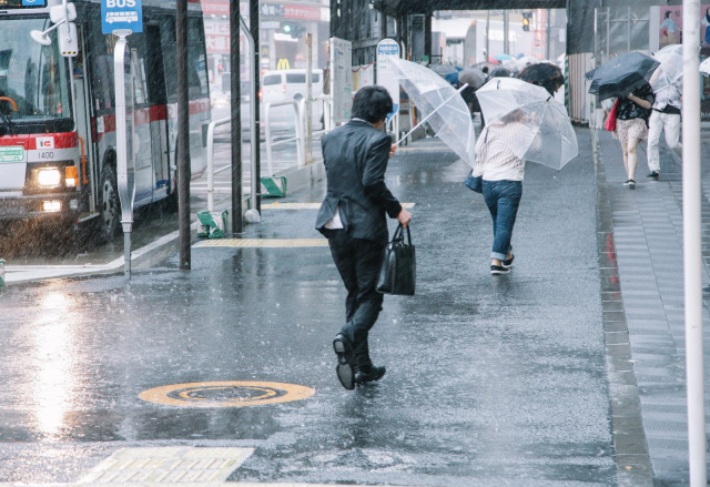 Japanese boy knows the one thing he needs when evacuating from typhoon, and it melts our hearts