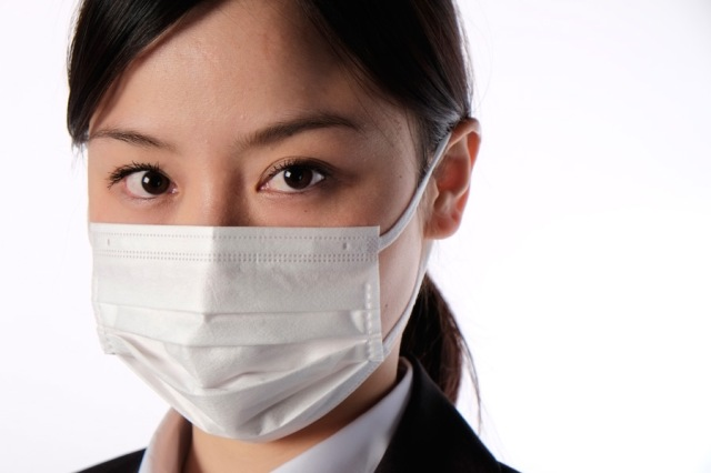 Hairs, insects and stains found in masks distributed by Japanese government
