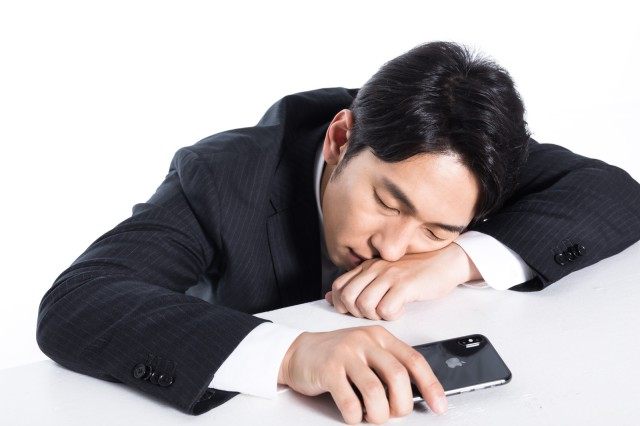 Japanese man comes up with ingenious (and slightly creepy) way to take a nap in meetings