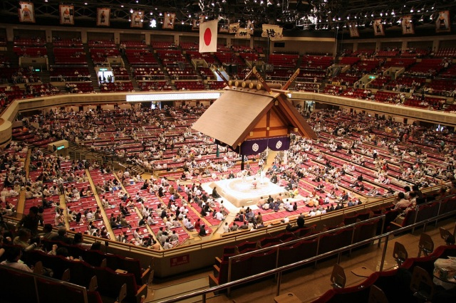 Photo of exciting end of sumo match looks like…a VERY different kind of excitement