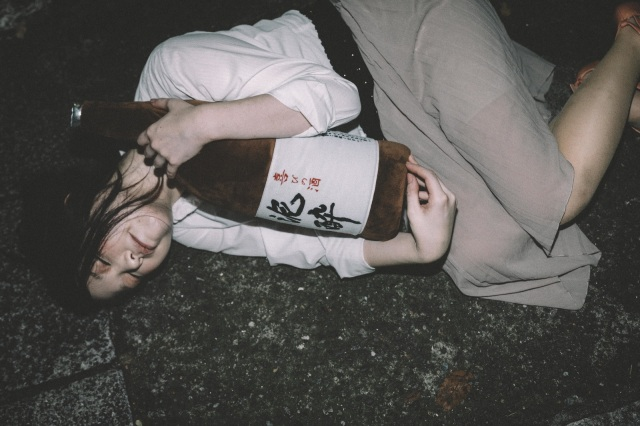 Japanese police ask drunk people to please stop sleeping in the middle of the street