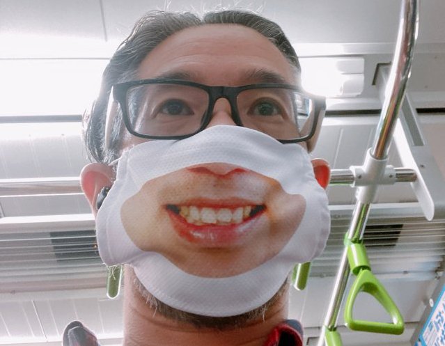 What happens when you wear a smile mask on a Japanese train?
