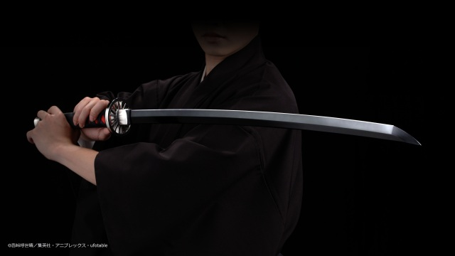 Wield a life-size replica of Tanjiro's demon-slaying Nichirin Blade for your next cosplay