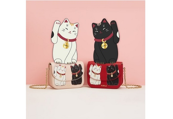 Invite some luck into your life this year with Furla's new Little Cats collection of merch